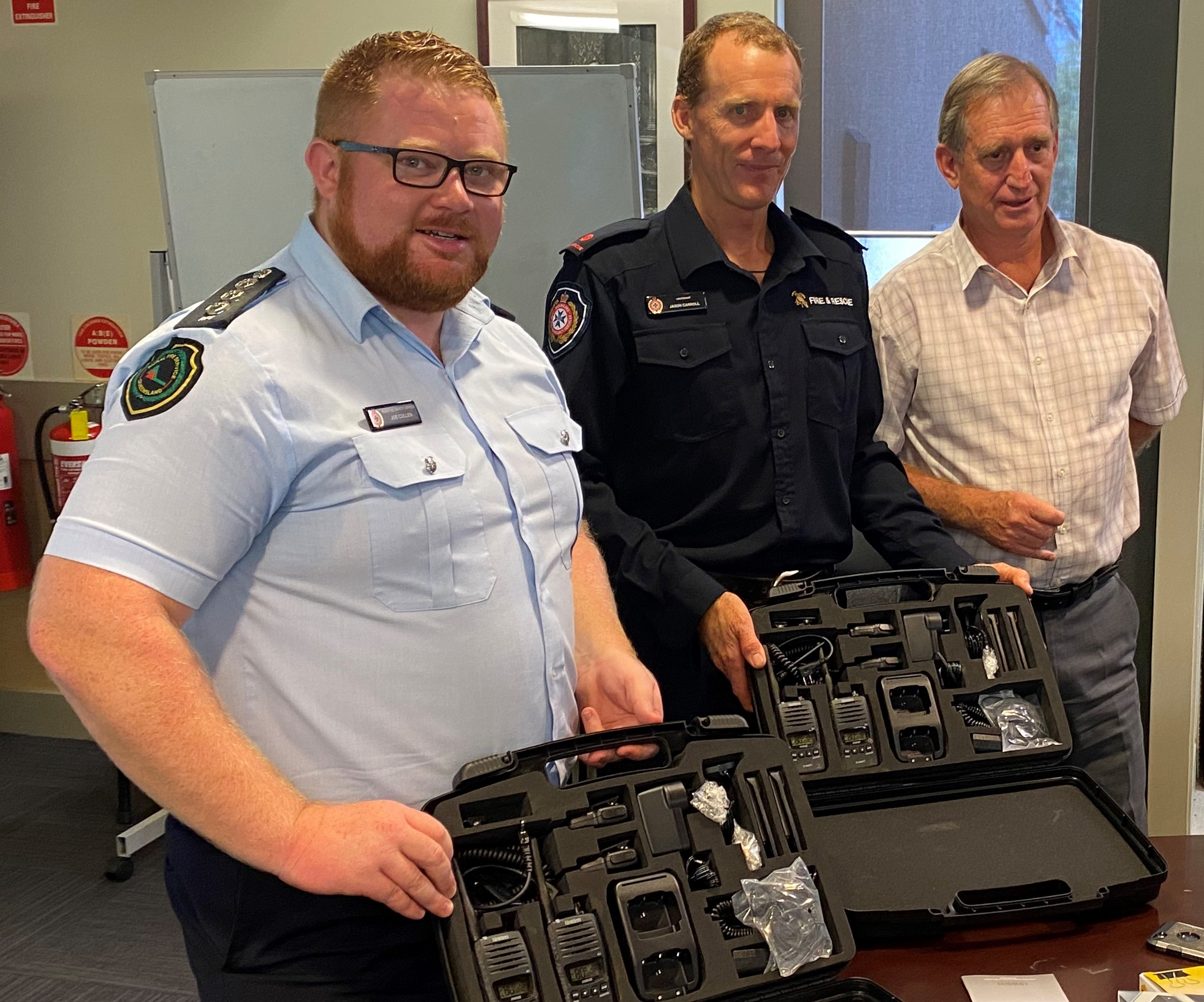 The radios were presented by Cr Scott at a recent meeting of the LDMG to Joe Cullen, Acting Inspector, Area Director of Cairns Peninsular Area Rural Fire Service, and Jason Carroll Captain of the Cooktown Auxiliary Fire Brigade.